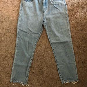 Light wash denim jeans with frayed bottoms